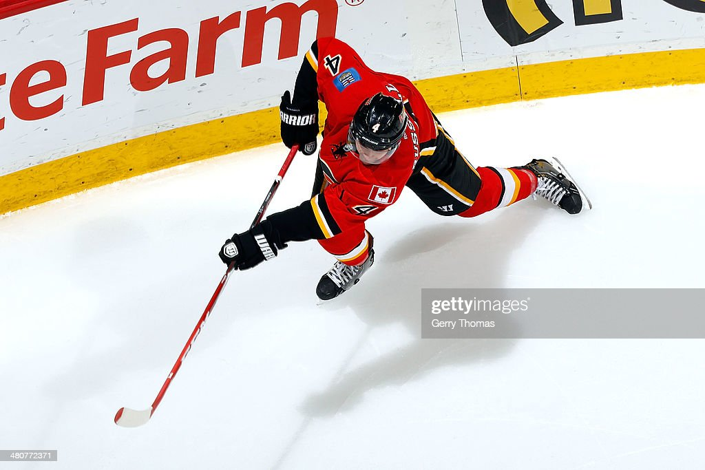 <a gi-track='captionPersonalityLinkClicked' href=/galleries/search?phrase=Kris+Russell&family=editorial&specificpeople=879805 ng-click='$event.stopPropagation()'>Kris Russell</a> #4 of the Calgary Flames shoots the puck against the Anaheim Ducks at Scotiabank Saddledome on March 26, 2014 in Calgary, Alberta, Canada.
