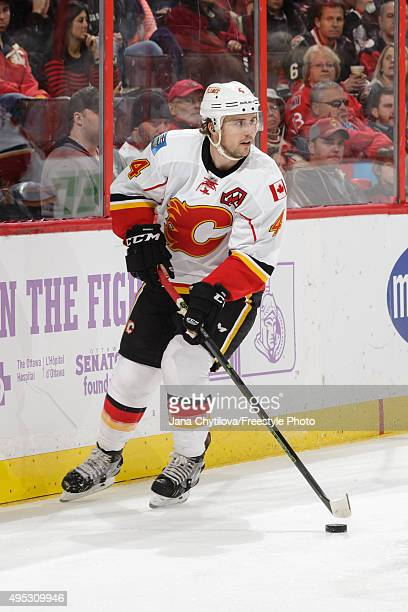 Kris Russell of the Calgary Flames skates with the puck during an NHL game against the Ottawa Senators at Canadian Tire Centre on October 28 2015 in...