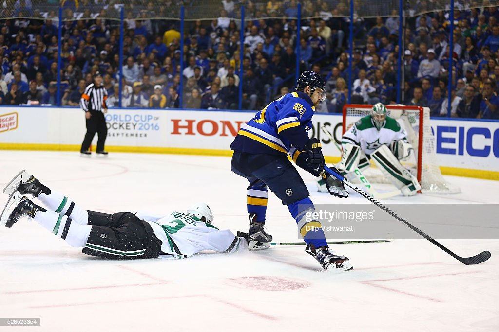<a gi-track='captionPersonalityLinkClicked' href=/galleries/search?phrase=Kris+Russell&family=editorial&specificpeople=879805 ng-click='$event.stopPropagation()'>Kris Russell</a> #2 of the Dallas Stars defends against <a gi-track='captionPersonalityLinkClicked' href=/galleries/search?phrase=Patrik+Berglund&family=editorial&specificpeople=540481 ng-click='$event.stopPropagation()'>Patrik Berglund</a> #21 of the St. Louis Blues in Game Four of the Western Conference Second Round during the 2016 NHL Stanley Cup Playoffs at the Scottrade Center on May 5, 2016 in St. Louis, Missouri.