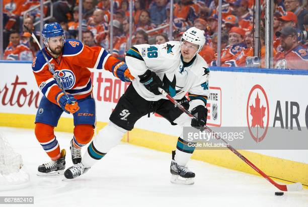 Kris Russell of the Edmonton Oilers battles against Tomas Hertl of the San Jose Sharks in Game One of the Western Conference First Round during the...