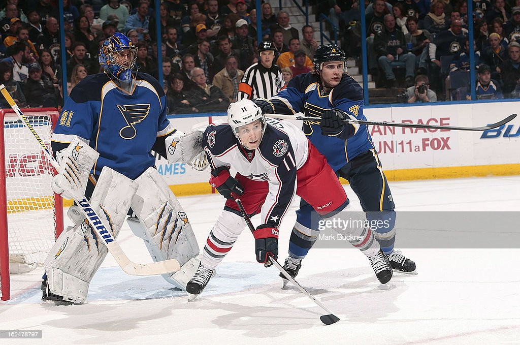 <a gi-track='captionPersonalityLinkClicked' href=/galleries/search?phrase=Kris+Russell&family=editorial&specificpeople=879805 ng-click='$event.stopPropagation()'>Kris Russell</a> #4 of the St. Louis Blues checks Matt Calvert #11 of the Columbus Blue Jackets in an NHL game on February 23, 2013 at Scottrade Center in St. Louis, Missouri.