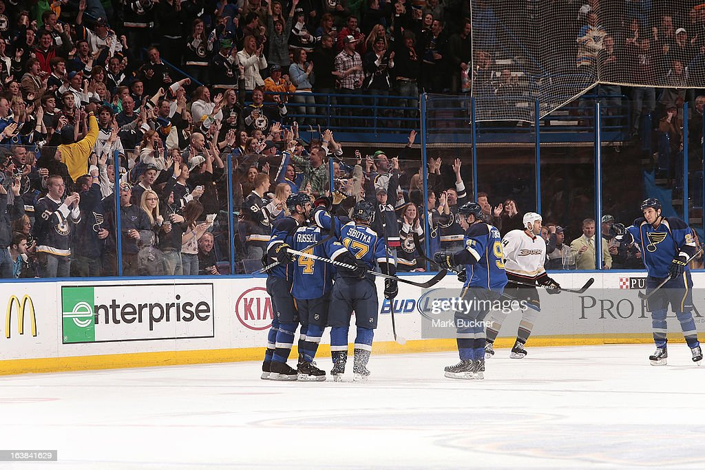 <a gi-track='captionPersonalityLinkClicked' href=/galleries/search?phrase=Kris+Russell&family=editorial&specificpeople=879805 ng-click='$event.stopPropagation()'>Kris Russell</a> #4 of the St. Louis Blues is congratulated by teammates after scoring a goal against the Anaheim Ducks in an NHL game on March 16, 2013 at Scottrade Center in St. Louis, Missouri.