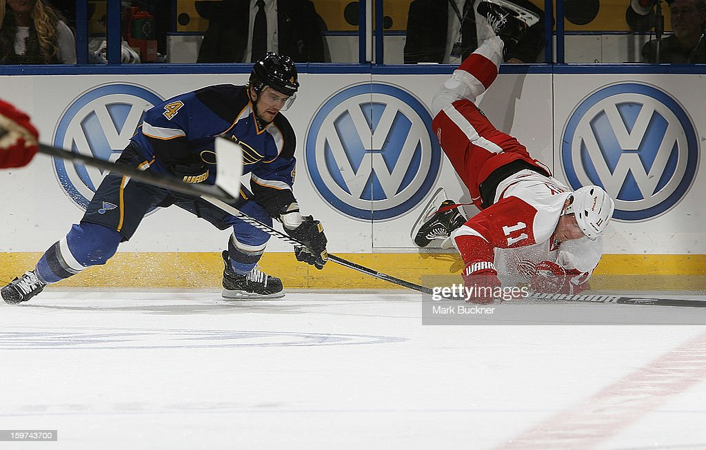 <a gi-track='captionPersonalityLinkClicked' href=/galleries/search?phrase=Kris+Russell&family=editorial&specificpeople=879805 ng-click='$event.stopPropagation()'>Kris Russell</a> #4 of the St. Louis Blues trips <a gi-track='captionPersonalityLinkClicked' href=/galleries/search?phrase=Daniel+Cleary&family=editorial&specificpeople=220490 ng-click='$event.stopPropagation()'>Daniel Cleary</a> #11 of the Detroit Red Wings in an NHL game on January 19, 2013 at Scottrade Center in St. Louis, Missouri.