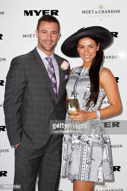 Kris Smith and Maddy King pose inside the Moet and Chandon Marquee during Spring Champion Stakes Day at Royal Randwick on October 12 2013 in Sydney...