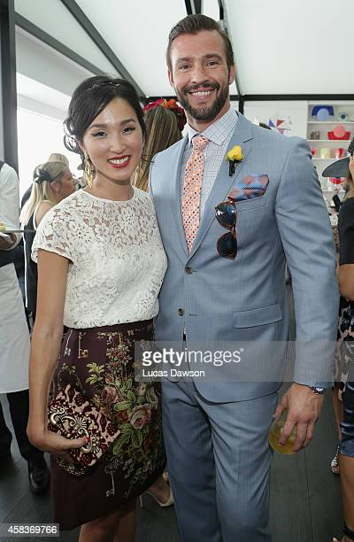 Kris Smith and Nicole Warne at the Myer Marquee on Melbourne Cup Day at Flemington Racecourse on November 4 2014 in Melbourne Australia