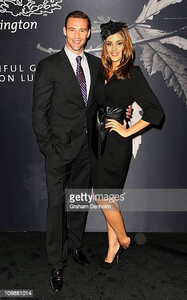Kris Smith and Rebecca Judd pose prior to the Flemington Beautiful Girls Fashion Lunch at The Atrium Flemington Racecourse on March 9 2011 in...