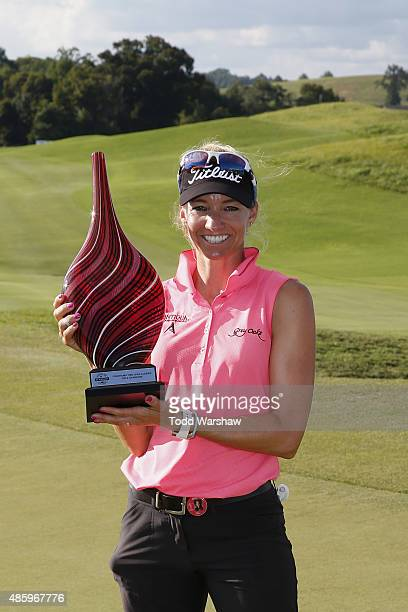 Kris Tamulis poses with the winner's trophy after winning the Yokohama Tire LPGA Classic at the Robert Trent Jones Golf Trail at Capitol Hill on...