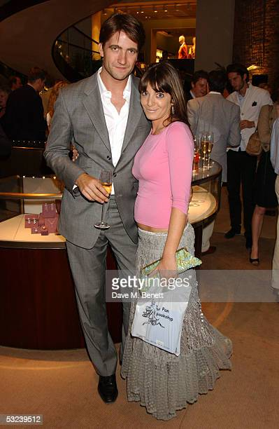 Kris Tykier and Claudia Winkleman attend Dylan Jones Book Launch Party of 'iPod Therefore I am'' at Asprey on July 14 2005 in London England