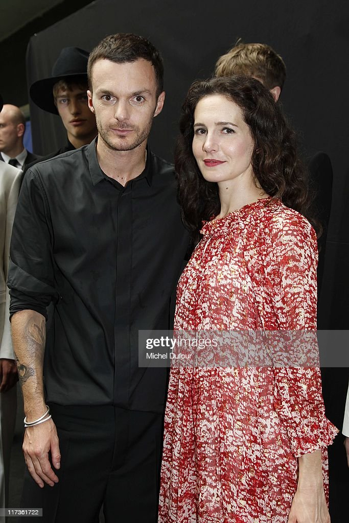 Kris Van Assche and Chloe Lambert attend the Dior Homme Menswear Spring/Summer 2012 show as part of Paris Fashion Week at on June 25, 2011 in Paris, France.