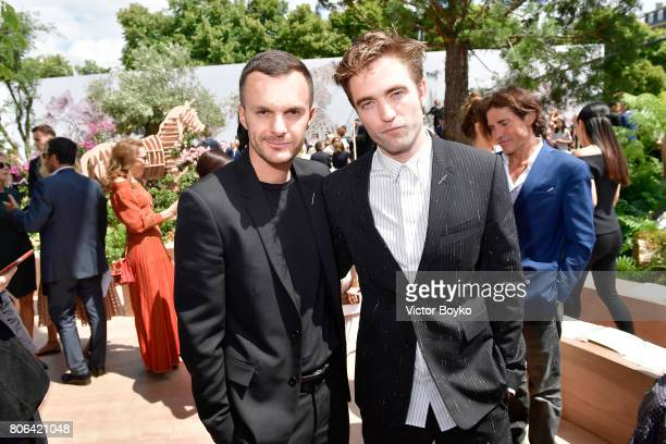 Kris Van Assche and Robert Pattinson attend the Christian Dior Haute Couture Fall/Winter 20172018 show as part of Haute Couture Paris Fashion Week on...