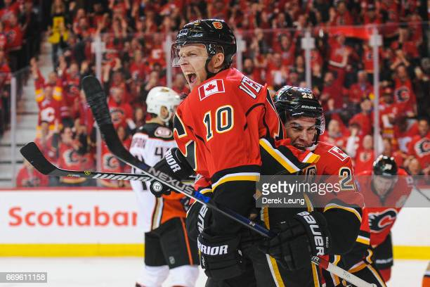 Kris Versteeg of the Calgary Flames celebrates with Sean Monahan after scoring against the Anaheim Ducks in Game Three of the Western Conference...