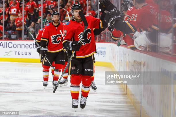 Kris Versteeg of the Calgary Flames salutes his teammates in an NHL game against the Minnesota Wild at the Scotiabank Saddledome on October 21 2017...