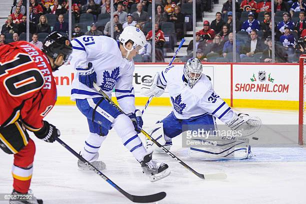 Kris Versteeg of the Calgary Flames shoots the puck past Jhonas Enroth of the Toronto Maple Leafs during an NHL game at Scotiabank Saddledome on...