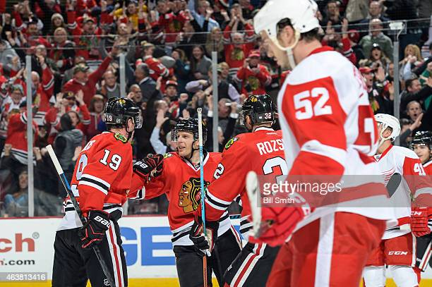 Kris Versteeg of the Chicago Blackhawks celebrates with teammates after scoring against the Detroit Red Wings to tie the game 22 in the third period...