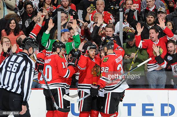Kris Versteeg of the Chicago Blackhawks celebrates with teammates after scoring against the Florida Panthers in the second period of the NHL game at...