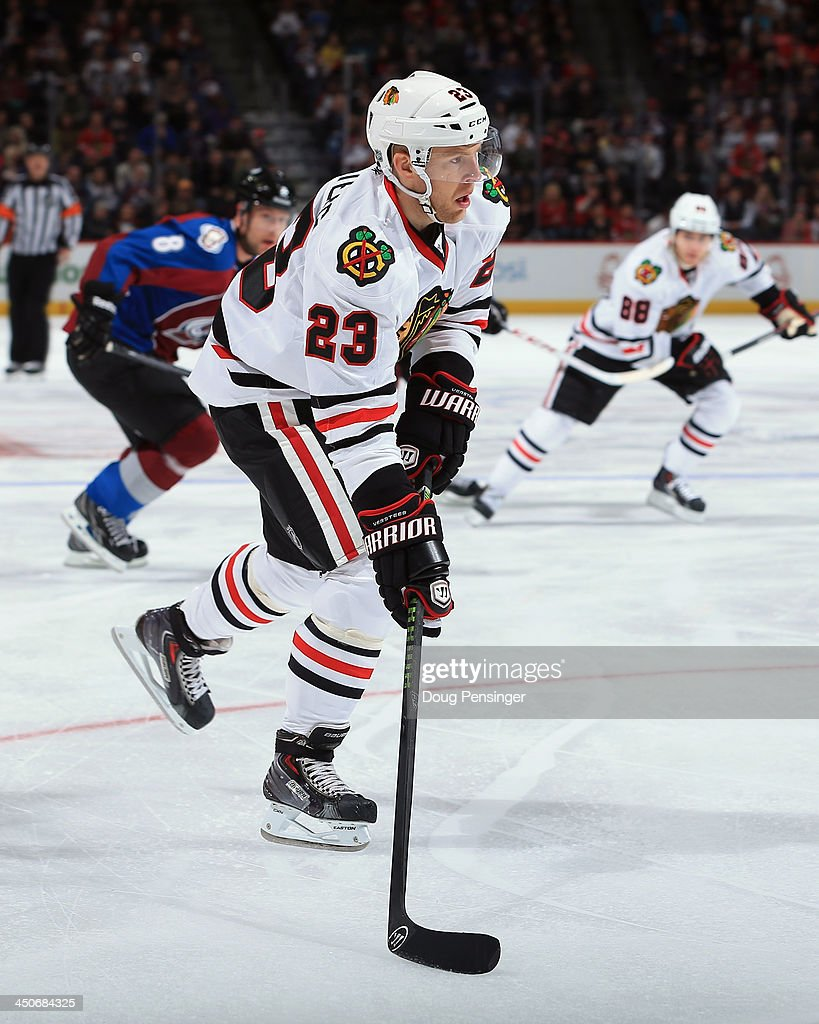 Kris Versteeg #23 of the Chicago Blackhawks controls the puck against the Colorado Avalanche at Pepsi Center on November 19, 2013 in Denver, Colorado. The Avalacnhe defeated the Blackhawks 5-1.