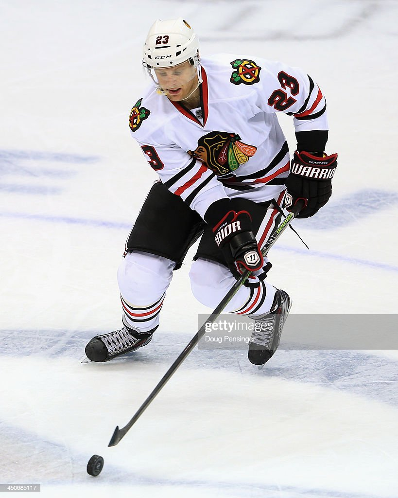 <a gi-track='captionPersonalityLinkClicked' href=/galleries/search?phrase=Kris+Versteeg&family=editorial&specificpeople=2242969 ng-click='$event.stopPropagation()'>Kris Versteeg</a> #23 of the Chicago Blackhawks controls the puck against the Colorado Avalanche at Pepsi Center on November 19, 2013 in Denver, Colorado. The Avalacnhe defeated the Blackhawks 5-1.