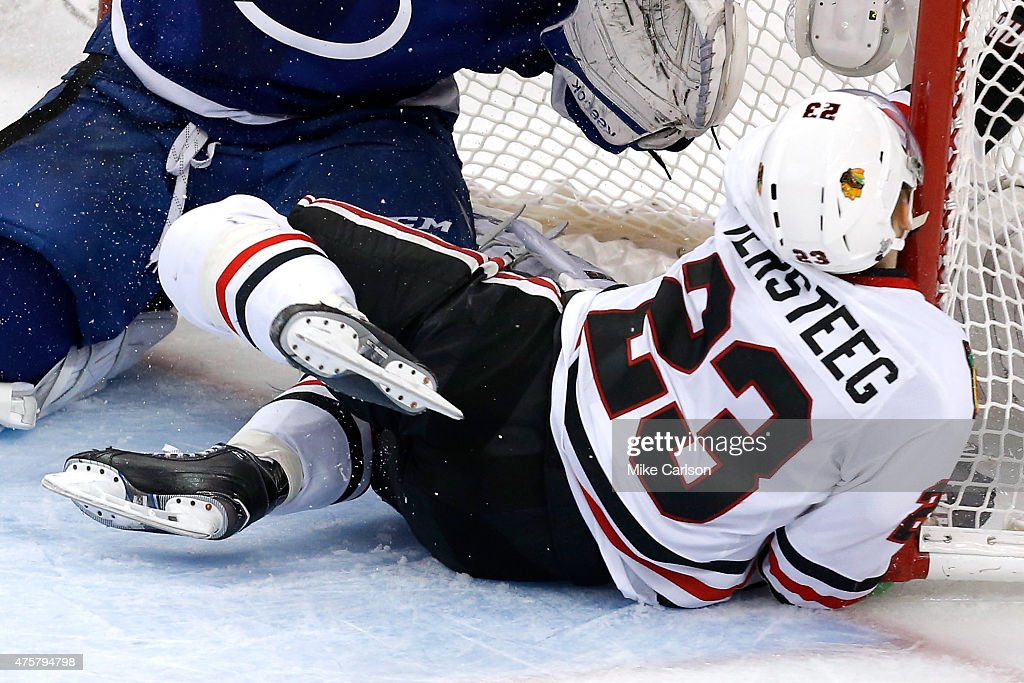 <a gi-track='captionPersonalityLinkClicked' href=/galleries/search?phrase=Kris+Versteeg&family=editorial&specificpeople=2242969 ng-click='$event.stopPropagation()'>Kris Versteeg</a> #23 of the Chicago Blackhawks crashes into the net against <a gi-track='captionPersonalityLinkClicked' href=/galleries/search?phrase=Ben+Bishop&family=editorial&specificpeople=700137 ng-click='$event.stopPropagation()'>Ben Bishop</a> #30 of the Tampa Bay Lightning during Game One of the 2015 NHL Stanley Cup Final at Amalie Arena on June 3, 2015 in Tampa, Florida.