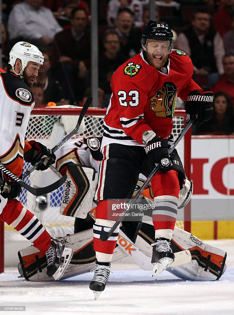 Kris Versteeg of the Chicago Blackhawks deflects the puck in front of Frederik Andersen of the Anaheim Ducks in the third period of Game Three of the...