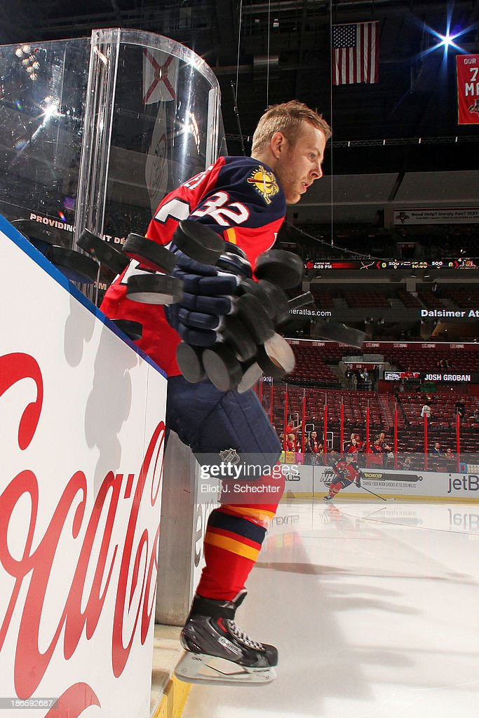 <a gi-track='captionPersonalityLinkClicked' href=/galleries/search?phrase=Kris+Versteeg&family=editorial&specificpeople=2242969 ng-click='$event.stopPropagation()'>Kris Versteeg</a> #32 of the Florida Panthers knocks practice pucks onto the ice prior to the start of the game against the St Louis Blues at the BB&T Center on November 1, 2013 in Sunrise, Florida.