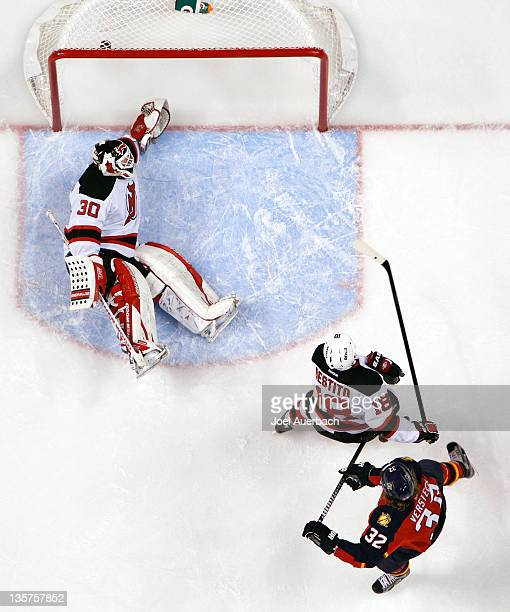 Kris Versteeg of the Florida Panthers scores a first period goal against goaltender Martin Brodeur of the New Jersey Devils on December 13 2011 at...