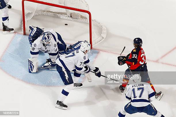 Kris Versteeg of the Florida Panthers scores a second period goal against goaltender Anders Lindback of the Tampa Bay Lightning at the BBT Center on...