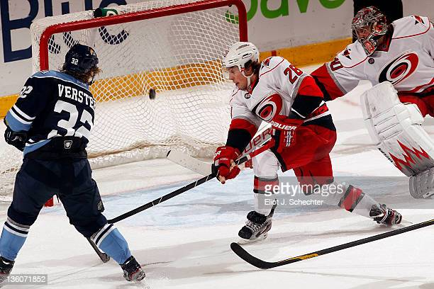 SUNRISE FL DECEMBER 18 Kris Versteeg of the Florida Panthers shoots and scores the game winning goal in overtime against the Carolina Hurricanes at...