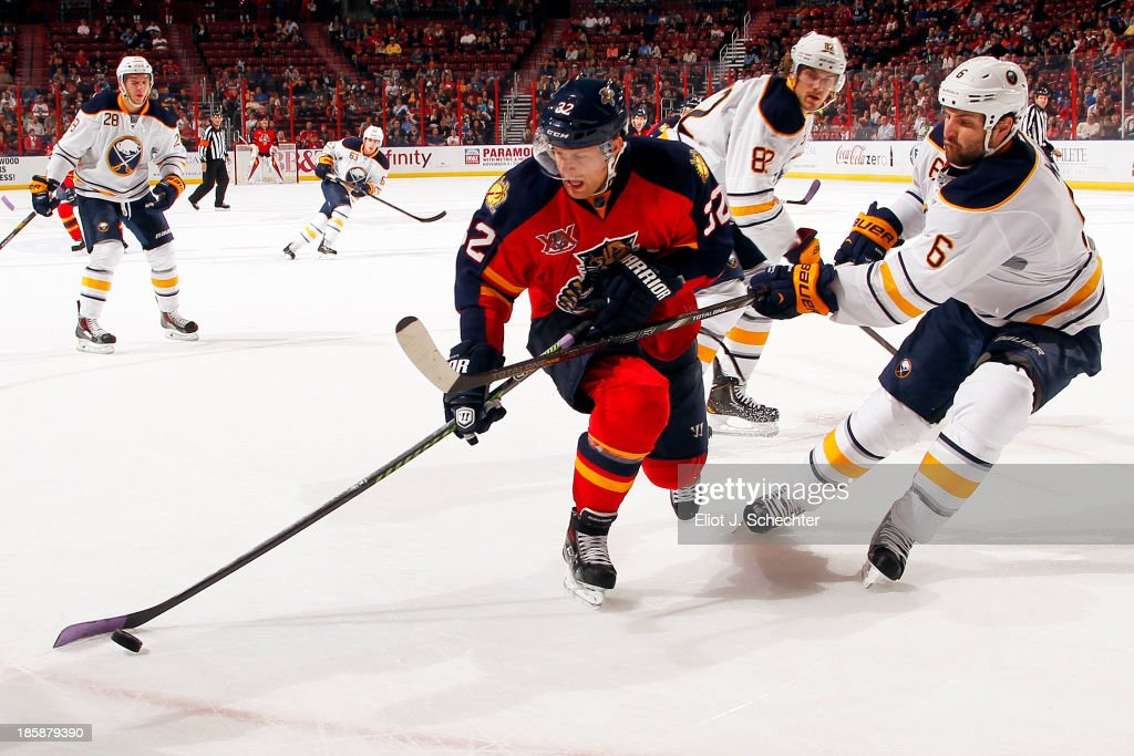 Kris Versteeg #32 of the Florida Panthers tangles with Mike Weber #6 of the Buffalo Sabres at the BB&T Center on October 25, 2013 in Sunrise, Florida.