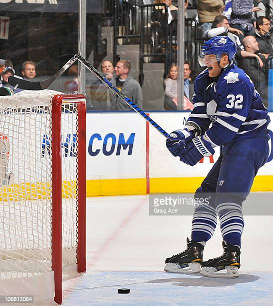 Kris Versteeg of the Toronto Maple Leafs smashes his stick over the cross bar during game action against the Vancouver Canucks November 13 2010 at...