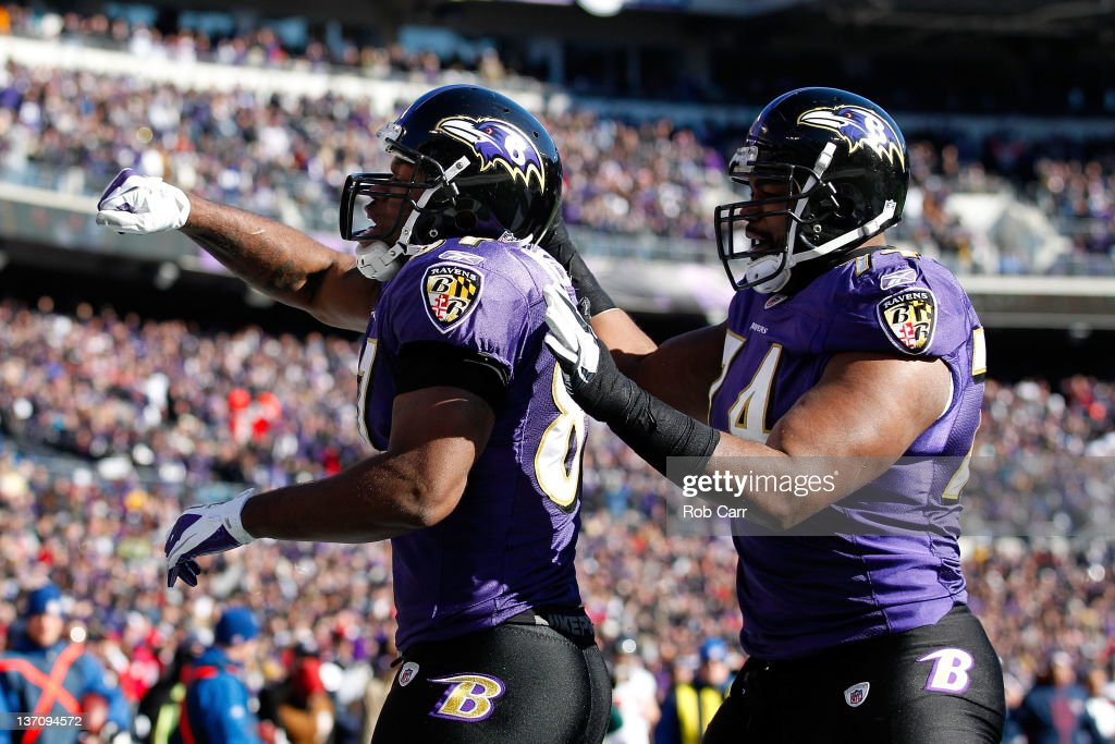 Kris Wilson #87 of the Baltimore Ravens celebrates his touchdown with teammate <a gi-track='captionPersonalityLinkClicked' href=/galleries/search?phrase=Michael+Oher&family=editorial&specificpeople=4077881 ng-click='$event.stopPropagation()'>Michael Oher</a> #74 during the first quarter against of the AFC Divisional playoff game against the Houston Texans at M&T Bank Stadium on January 15, 2012 in Baltimore, Maryland.
