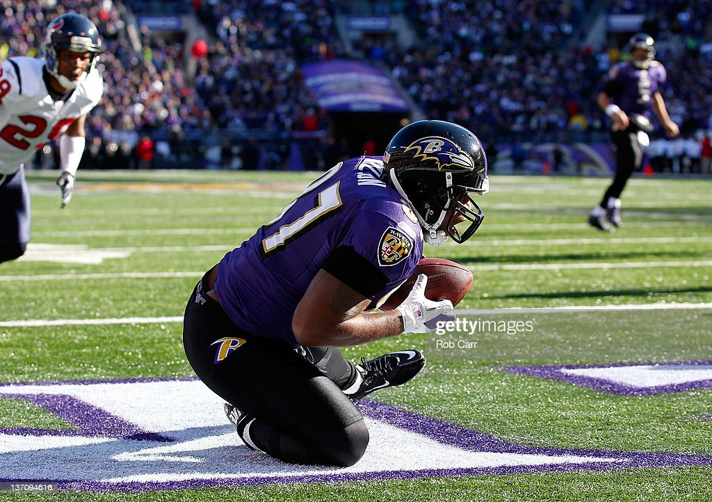 Kris Wilson #87 of the Baltimore Ravens scores a touchdown in the first quarter against the Houston Texans during the AFC Divisional playoff at M&T Bank Stadium on January 15, 2012 in Baltimore, Maryland.