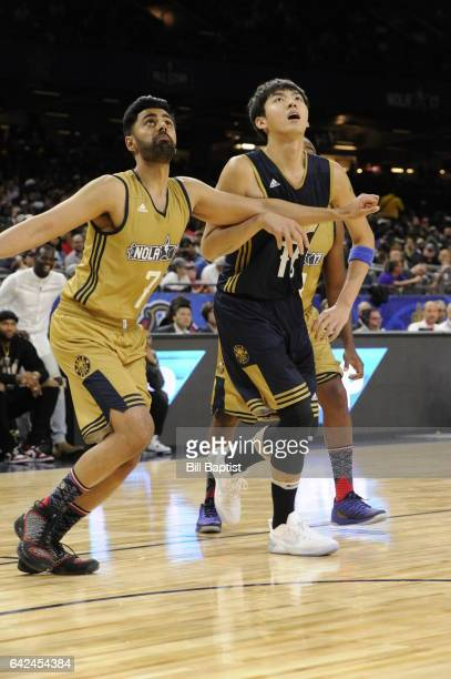 Kris Wu of the East Team and Hasan Minhaj West Team battle for the rebound during the NBA AllStar Celebrity Game as a part of 2017 AllStar Weekend at...