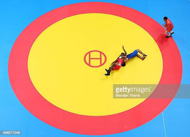 Krishankant Yadav of India competes with Saeid Abdvali of Iran in the Men's GrecoRoman 71kg Bronze Medal Match during day eleven of the 2014 Asian...
