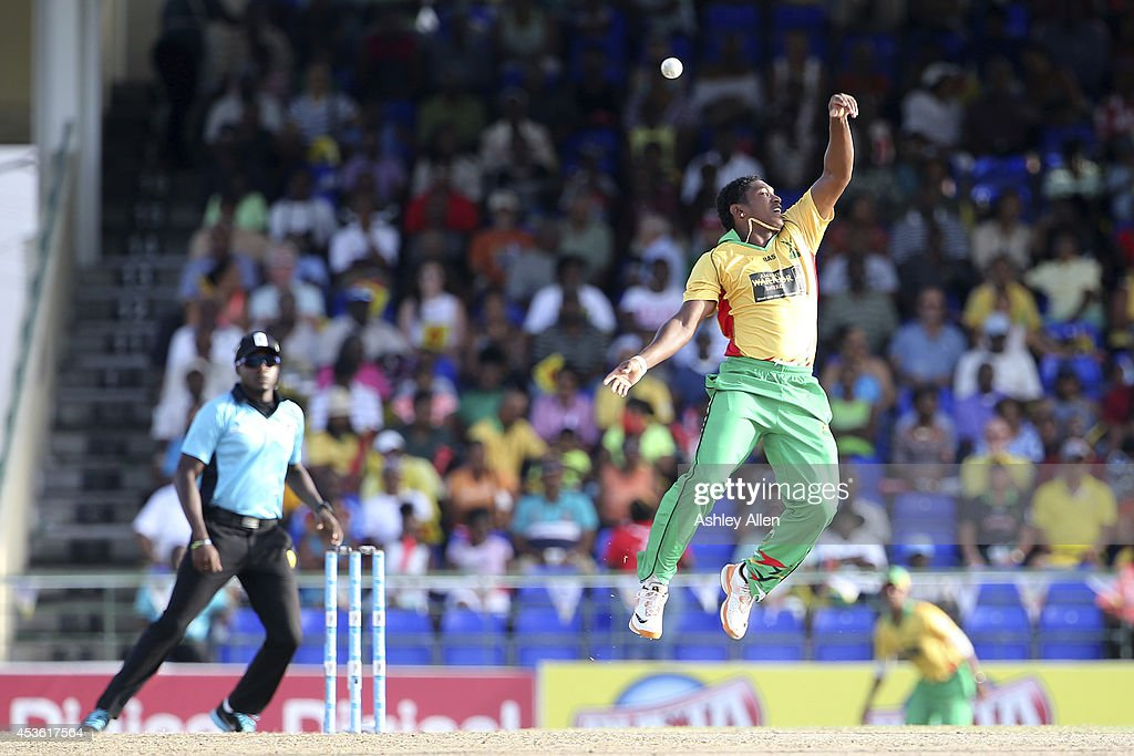 Krishmar Santokie deflects the ball onto the stumps leading to the run out of <a gi-track='captionPersonalityLinkClicked' href=/galleries/search?phrase=Andre+Russell&family=editorial&specificpeople=5348594 ng-click='$event.stopPropagation()'>Andre Russell</a> during a Semifinal match between Jamaica Tallawahs and Guyana Amazon Warriors as part of the Limacol Caribbean Premier League 2014 at Warner Park on August 14, 2014 in Basseterre, St. Kitts and Nevis.