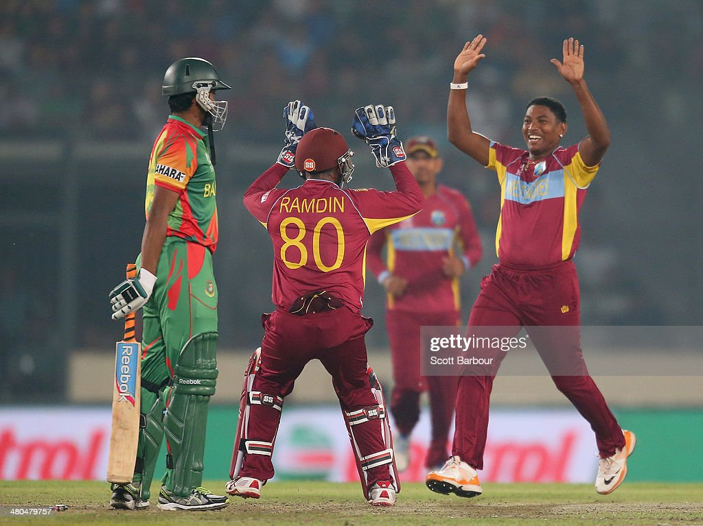 Krishmar Santokie of the West Indies celebrates after bowling <a gi-track='captionPersonalityLinkClicked' href=/galleries/search?phrase=Shakib+Al+Hasan&family=editorial&specificpeople=4145971 ng-click='$event.stopPropagation()'>Shakib Al Hasan</a> of Bangladesh during the ICC World Twenty20 Bangladesh 2014 match between Bangladesh and the West Indies at Sher-e-Bangla Mirpur Stadium on March 25, 2014 in Dhaka, Bangladesh.