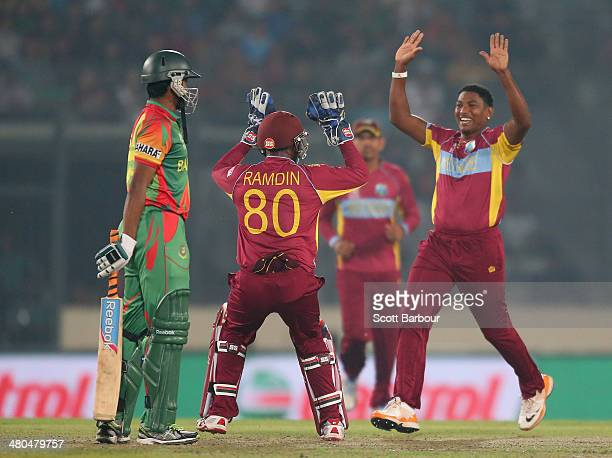 Krishmar Santokie of the West Indies celebrates after bowling Shakib Al Hasan of Bangladesh during the ICC World Twenty20 Bangladesh 2014 match...