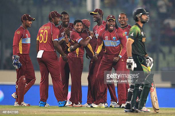 Krishmar Santokie of the West Indies is congratulated on bowling Ahmed Shehzad of Pakistan for LBW during the ICC World Twenty20 Bangladesh 2014...