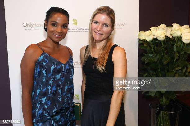 Krishna Daly and Sabine Schmitt attend the Tracy Paul Company for Only Roses Launch Beverly Hills on October 12 2017 in Los Angeles California
