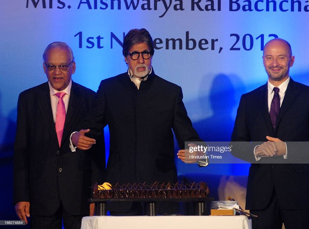 Krishna Rai father of Aishwaiya Rai Bachachan, <a gi-track='captionPersonalityLinkClicked' href=/galleries/search?phrase=Amitabh+Bachchan&family=editorial&specificpeople=220394 ng-click='$event.stopPropagation()'>Amitabh Bachchan</a> and French Ambassador to India Francois Richier during a function to confer Aishwarya Rai Bachchan with French Knight of the Order of Arts and Letters for her contribution to the arts on November 1, 2012 in Mumbai, India. She also celebrated also celebrated her 39th birthday.
