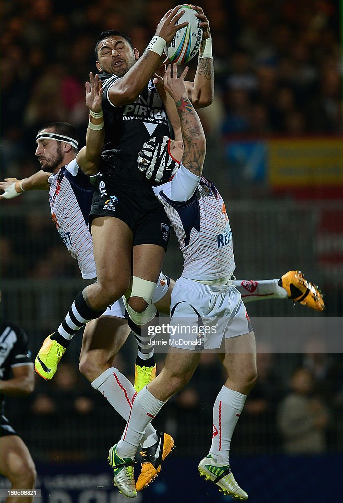 Krisnan Inu of New Zealand jumps with Theo Fagas and Vincent Duport of France during the Rugby League World Cup group B match between New Zealand and France at Parc des Sports on November 1, 2013 in Avignon, France.