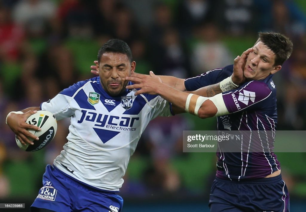 Krisnan Inu of the Bulldogs is tackled by Gareth Widdop of the Storm during the round three NRL match between the Melbourne Storm and the Canterbury Bulldogs at AAMI Park on March 21, 2013 in Melbourne, Australia.