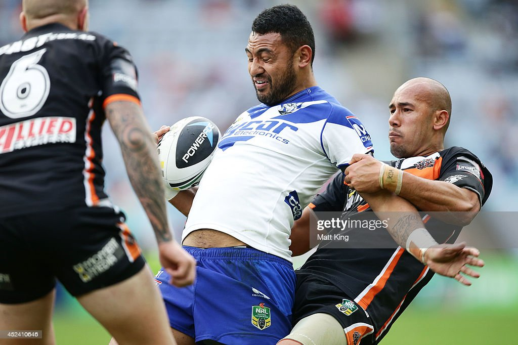 Krisnan Inu of the Bulldogs is tackled during the round 19 NRL match between the Wests Tigers and the Canterbury Bulldogs at ANZ Stadium on July 20, 2014 in Sydney, Australia.