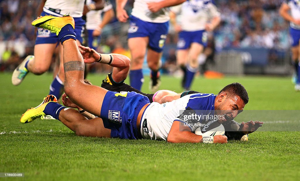 Krisnan Inu of the Bulldogs scores a try during the round 25 NRL match between the Canterbury Bulldogs and the Penrith Panthers at ANZ Stadium on August 31, 2013 in Sydney, Australia.