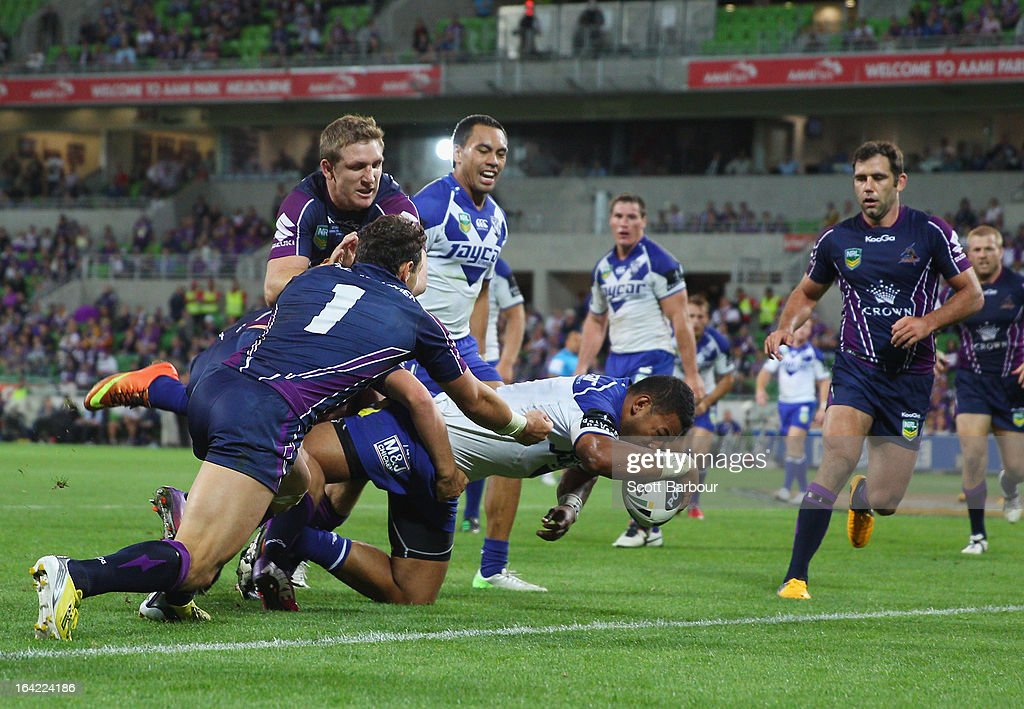 Krisnan Inu of the Bulldogs scores a try during the round three NRL match between the Melbourne Storm and the Canterbury Bulldogs at AAMI Park on March 21, 2013 in Melbourne, Australia.