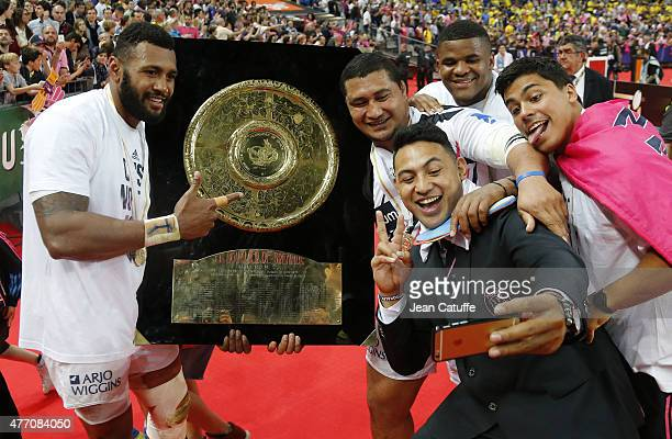 Krisnan Inu Sakaria Taulafo Jonathan Danty celebrate winning the Bouclier de Brennus Trophy after the Top 14 Final between ASM Clermont Auvergne and...