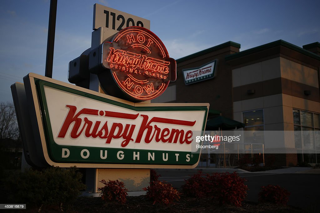 Krispy Kreme Doughnuts Inc. signage is displayed outside of a store in Farragut, Tennessee, U.S., on Wednesday, Dec. 5, 2013. The doughnut chain plans to add at least 30 new U.S. stores next year and is opening up new markets for franchising. Photographer: Luke Sharrett/Bloomberg via Getty Images