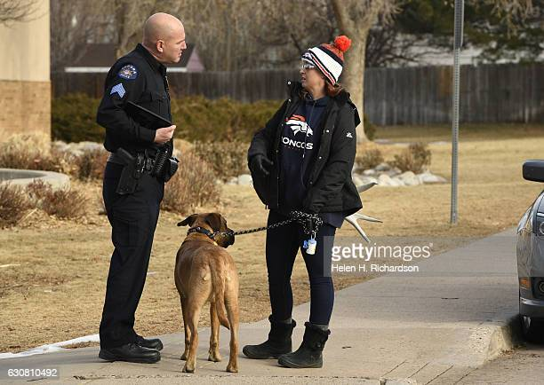 Krissy Mosbarger with her dog Bruiser right talk to Aurora police Sgt Chris Amsler left about helping in the continued search for missing 6 year old...