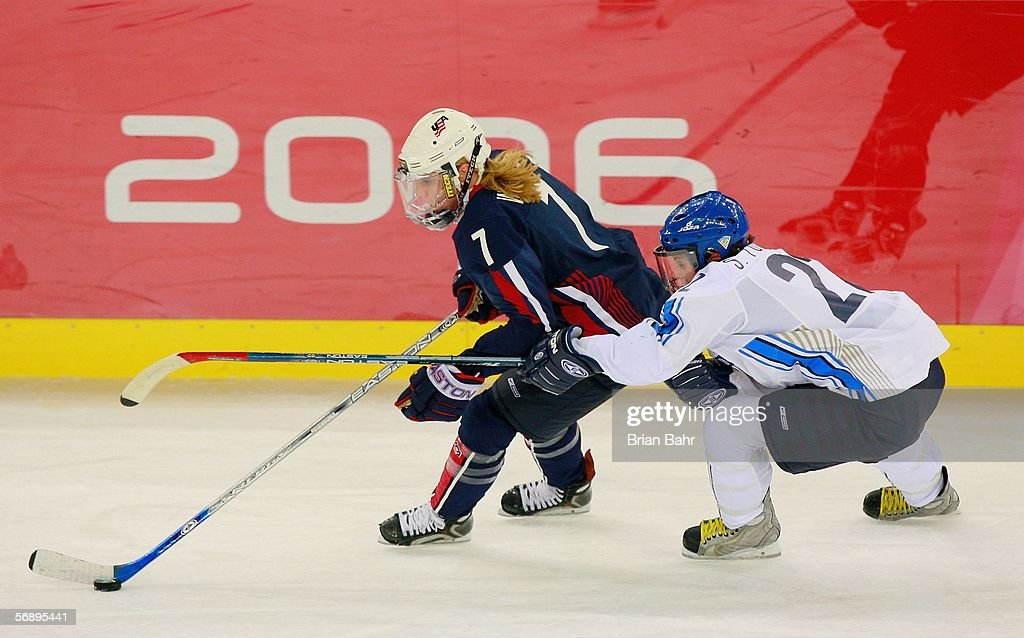Krissy Wendell #7 of the United States and Saara Tuominen #22 of Finland fight for the puck during the women's ice hockey bronze medal match during Day 10 of the Turin 2006 Winter Olympic Games on February 20, 2006 at the Palasport Olimpico in Turin, Italy.