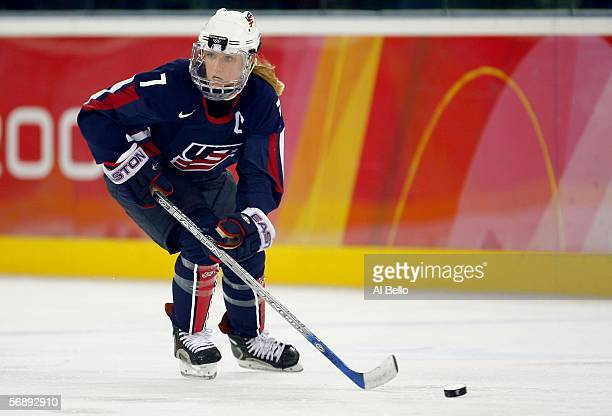 Krissy Wendell of the United States controls the puck during the women's ice hockey bronze medal match against Finland during Day 10 of the Turin...