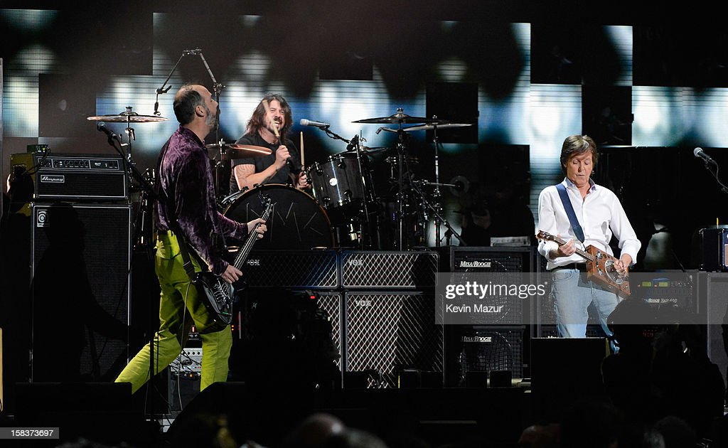 Krist Novoselic, Dave Grohl and Sir Paul McCartney perform at '12-12-12' a concert benefiting The Robin Hood Relief Fund to aid the victims of Hurricane Sandy presented by Clear Channel Media & Entertainment, The Madison Square Garden Company and The Weinstein Company at Madison Square Garden on December 12, 2012 in New York City.